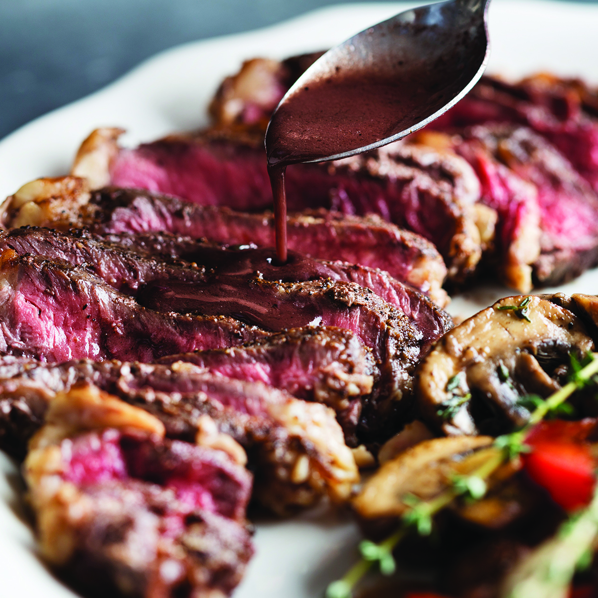 Broiled Grass-Fed Ribeye with Red Wine Mushrooms & Peppers